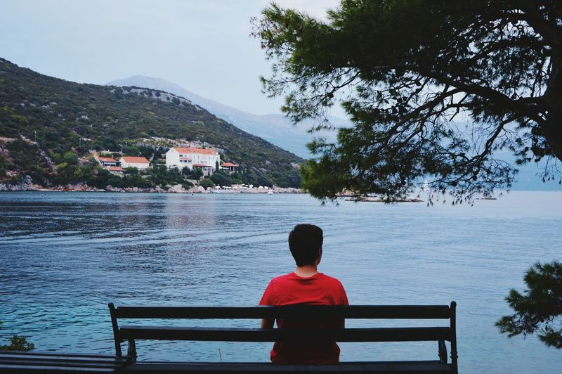 Rear View Water Child Sitting Politics And Government Childhood One Person Outdoors People Day Sky Nature Adult Seaside Water Summer Dubrovnik Croatia Red Long Goodbye EyeEmNewHere Lost In The Landscape
