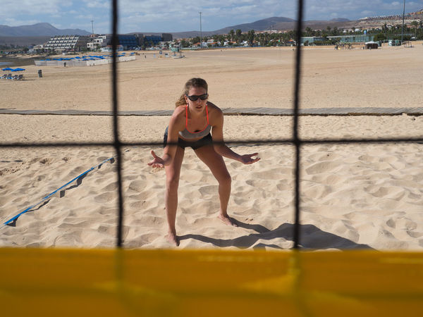 beach volleyball - athletic woman is in the defense waiting for the volley ball Activity Adult Assumption Athletic Beach Beach Volleyball Beachvolleyball Concentration Court Day Defense Front View Full Length Leisure Activity Net One Person Outdoors People Sky Sport Sportive Strong Woman Volley Volleyball Woman