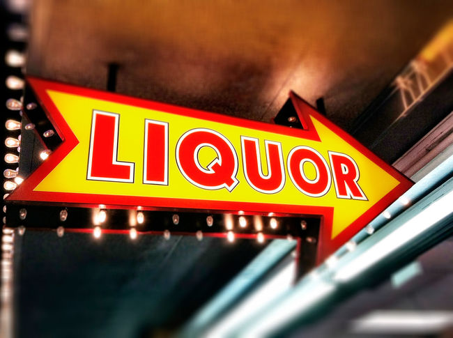 "The word ""liquor"" on lit sign pointing to liquor store Advertising Alcohol Arrow Booze Communication Concept Direction Drink Elecric Guidance Illuminated Information Information Sign Las Vegas Liquor Liquor Store Nevada Night Nightlife Nobody Party Supplies Pointing Sign Store Urban"