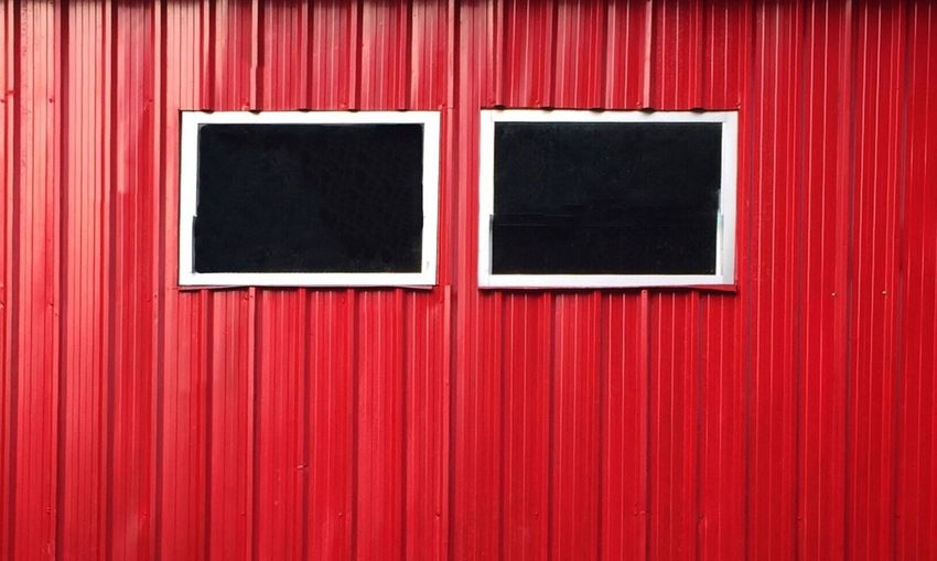 Windows On Red Corrugated Wall