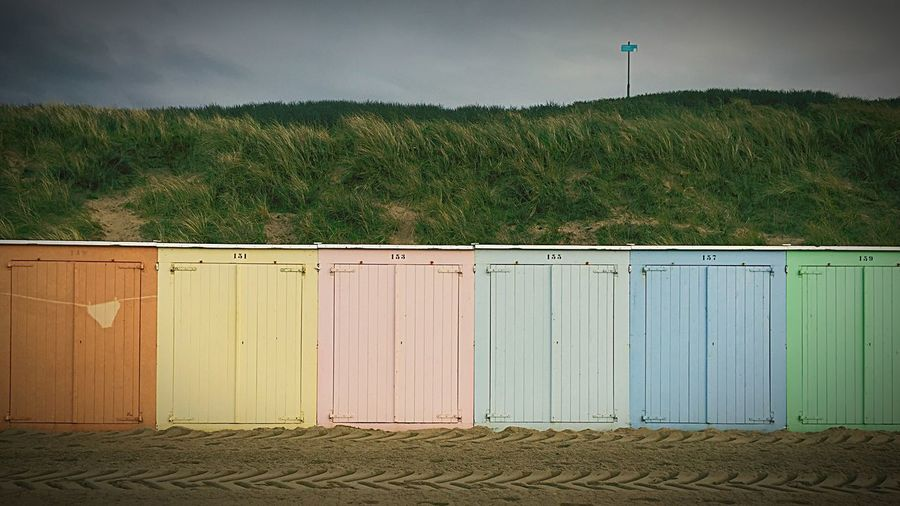 Multi colored huts on beach