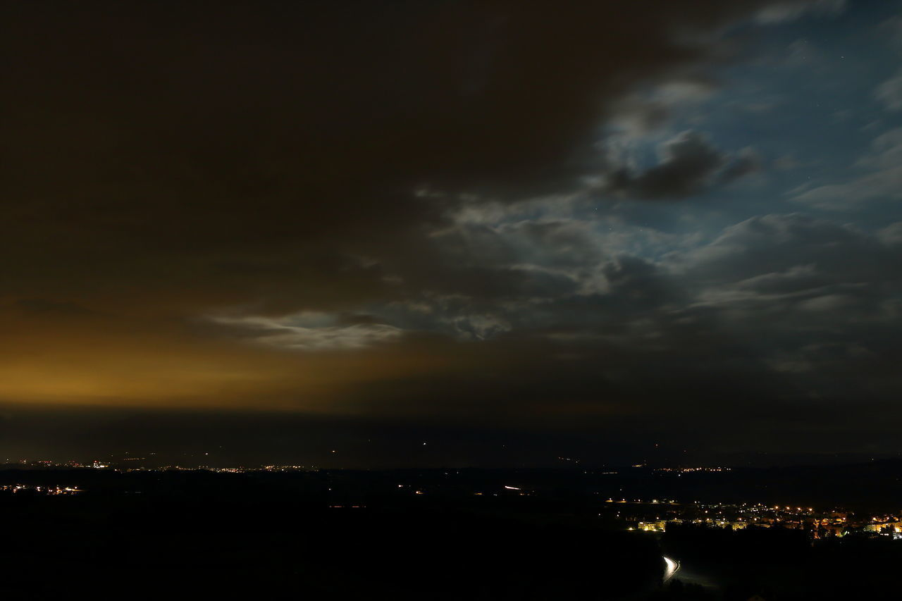 sky, cloud - sky, beauty in nature, nature, no people, night, weather, dramatic sky, scenics, silhouette, tranquility, sunset, tranquil scene, outdoors, illuminated, storm cloud, building exterior, cityscape, city