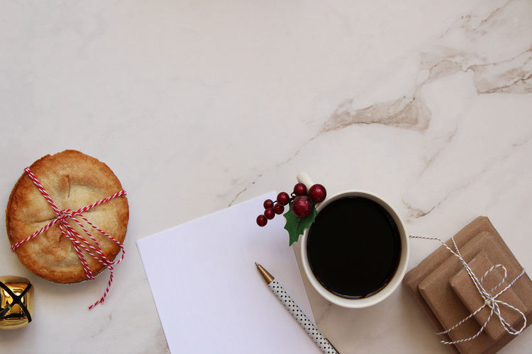 Festive desktop Christmas Coffee Copy Space Desk Presents Winter Above Backgrounds Blank Paper Desk From Above Directly Above Food Food And Drink Frame Freshness Gifts List Notes Paper Pen Pie Still Life Sweet Food Table To Do