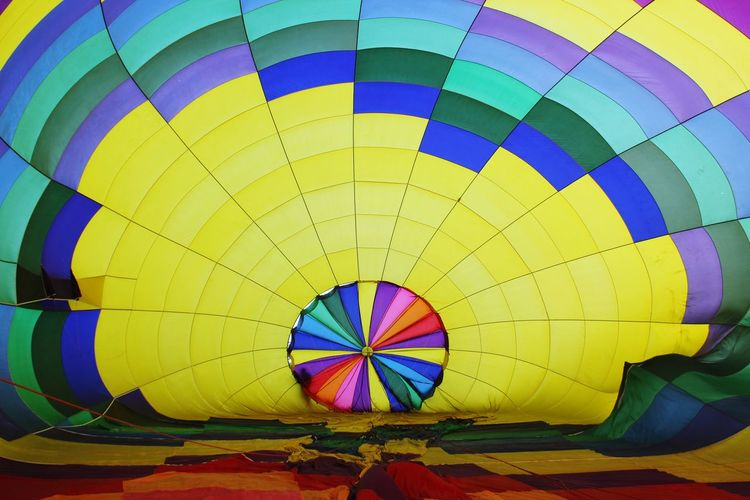 Inside a hot air balloon! Multi Colored Hot Air Balloon Balloon Pattern Air Vehicle Transportation No People Day Adventure Outdoors Mode Of Transportation Geometric Shape Design Yellow Ballooning Festival A New Beginning