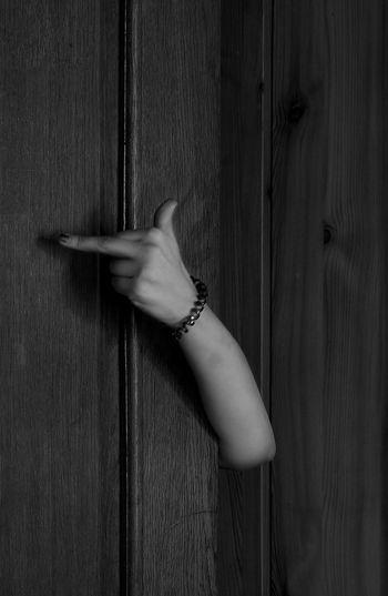 Close-up of hand obscene gesture on door