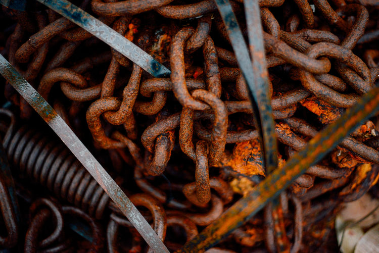Rusty steel chains and springs in an industrial boat yard in the archipelago Chain Chains Close-up Industrial Iron Man Made Object Metal Rust Rusty Spring Steel Weathered