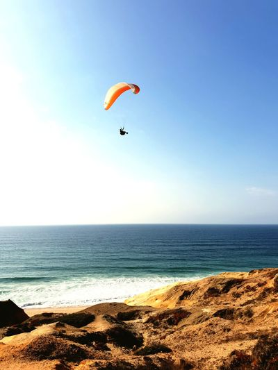 Paragliding Paragliding Water Flying Sea Beach Extreme Sports Sand Mid-air Jumping Full Length Gliding Surf Tide Coast