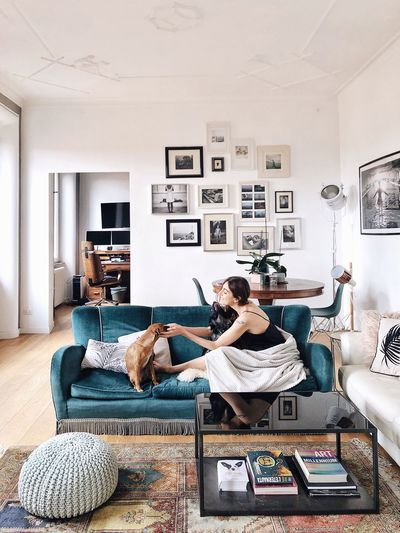 People sitting on sofa at home