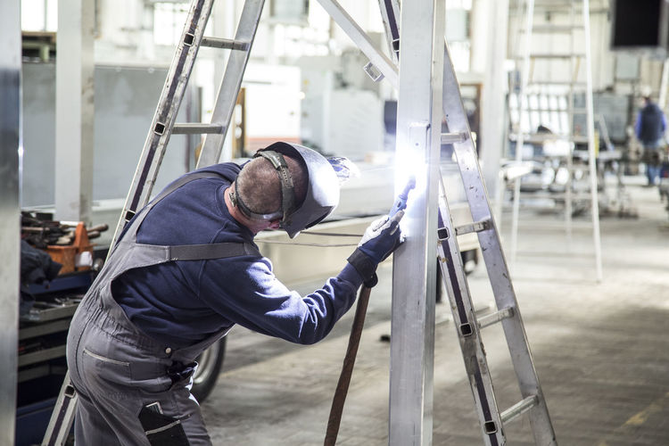 Construction Worker Welding At Workshop