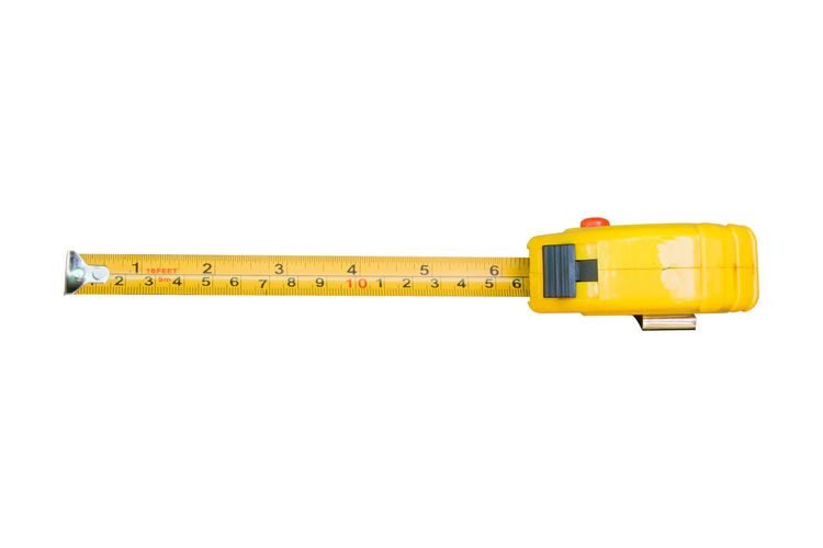 Tape measure yellow colour on white background Construction Industry Scale  Building Built Close-up Communication Cut Out Equipment Indoors  No People Number Rule Single Object Still Life Studio Shot Tape Measure Technology Tool White Background Yellow