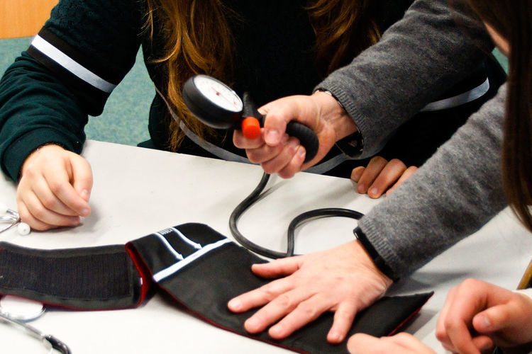 High angle view of people examining blood pressure gauge