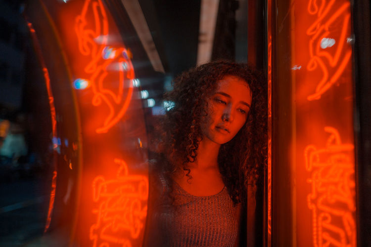 Ellie Portrait Of A Woman Portrait Photography Portrait Neon Lights Neon Lights Red Neon Red Hong Kong Beauty Curly Hair Red Illuminated Beautiful Woman Girls Headshot Close-up Introspection Thoughtful Pensive Loneliness Caucasian