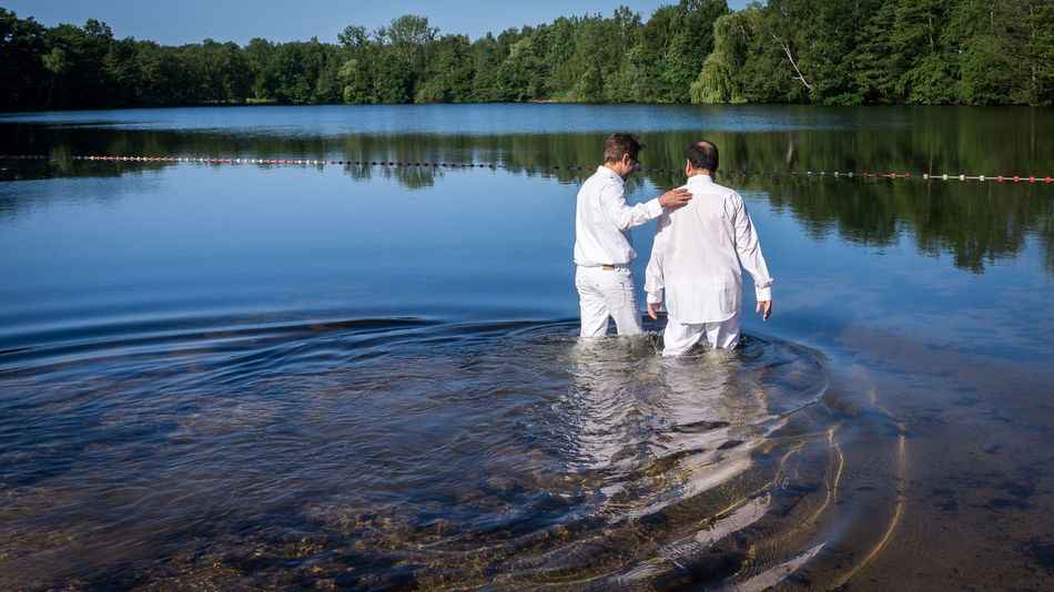 Decisions Adult Baptism Beauty In Nature Couple - Relationship Day Emotion Full Length Lake Love Men Nature Outdoors Plant Positive Emotion Rear View Religion Standing Testimony Togetherness Two People Water