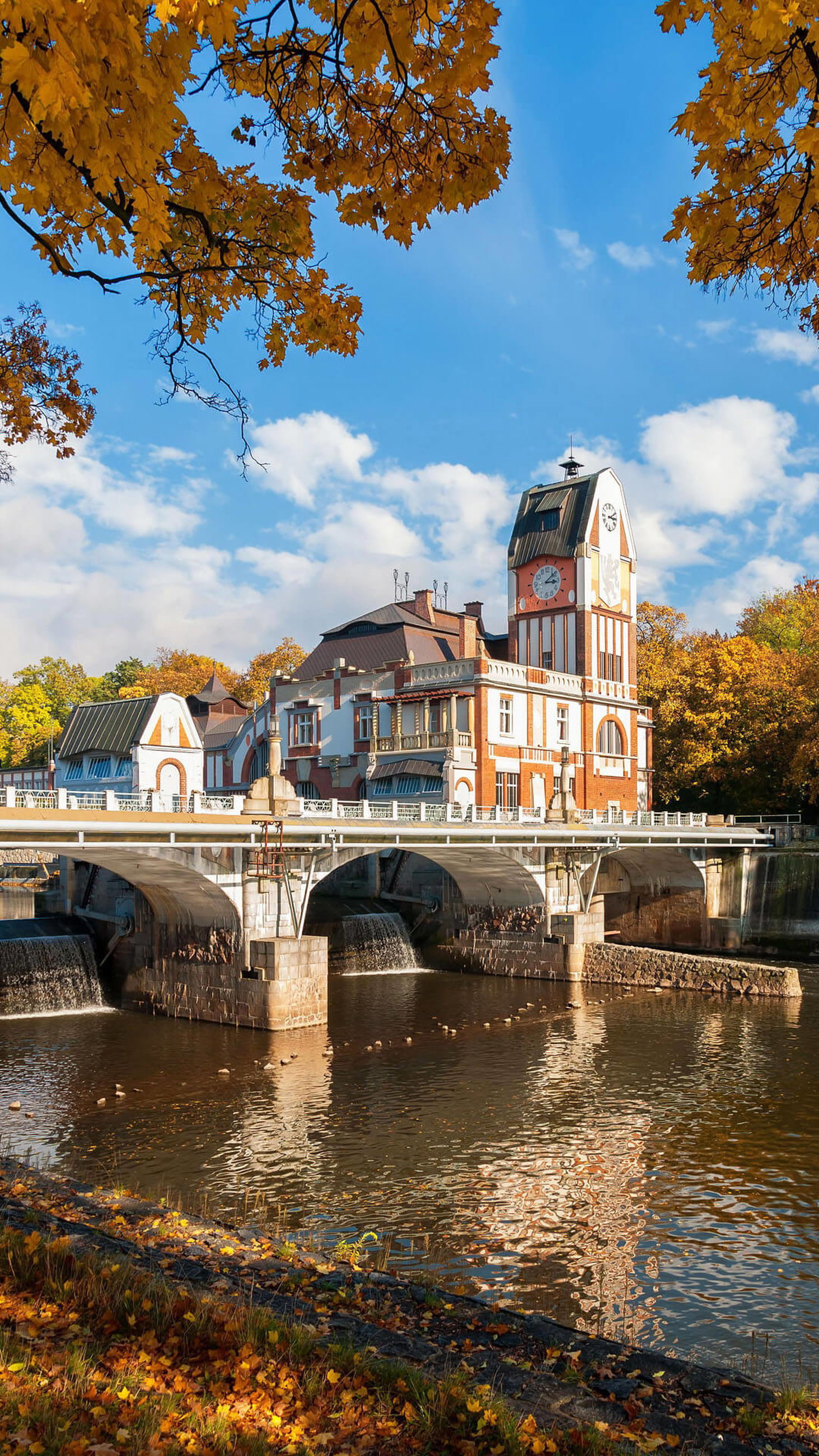 built structure, architecture, building exterior, water, connection, tree, bridge - man made structure, sky, river, arch, bridge, city, arch bridge, cloud, waterfront, day, branch, cloud - sky, blue, town, outdoors, canal, no people, seine river