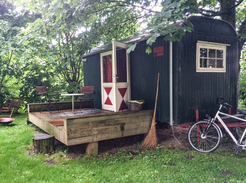 Architecture Bicycle Broom Built Structure Day Lawn Mode Of Transport No People Outdoors Parked Residential Structure Terrace Tiny House  Tree