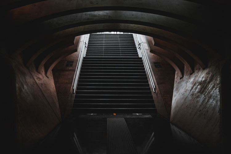 High angle view of empty staircase in tunnel