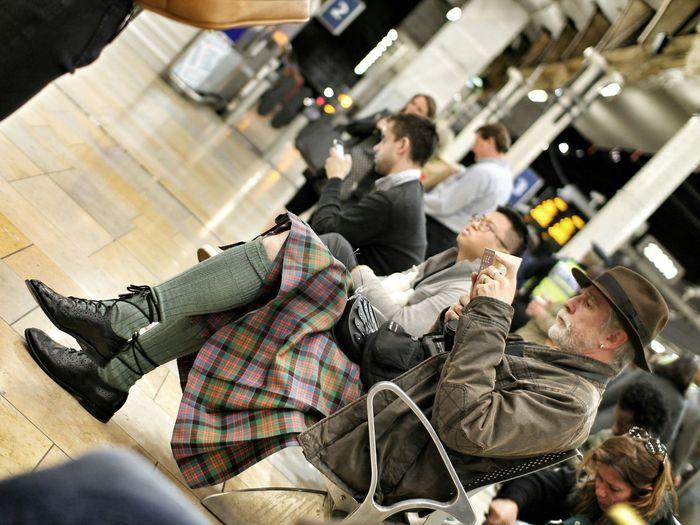 Travel. Read. Meet other people Londra Discover  Londonlife Urban Paddington Traveling Paddington Station Waiting Kilt Scottish Socks Traditions Book People Streetphotography Streetphoto_color London Reading Street Station Stazione Attesa