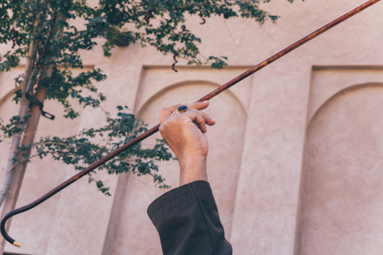 Arabic man spinning stick yowla