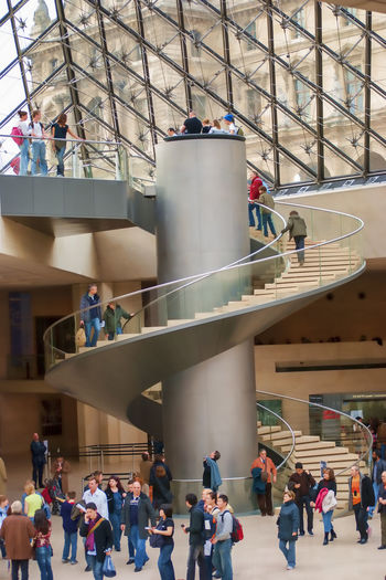 Winding Staircase Architecture Built Structure City Day Indoors  Large Group Of People Lifestyles Men Modern Museum People Real People Standing Women