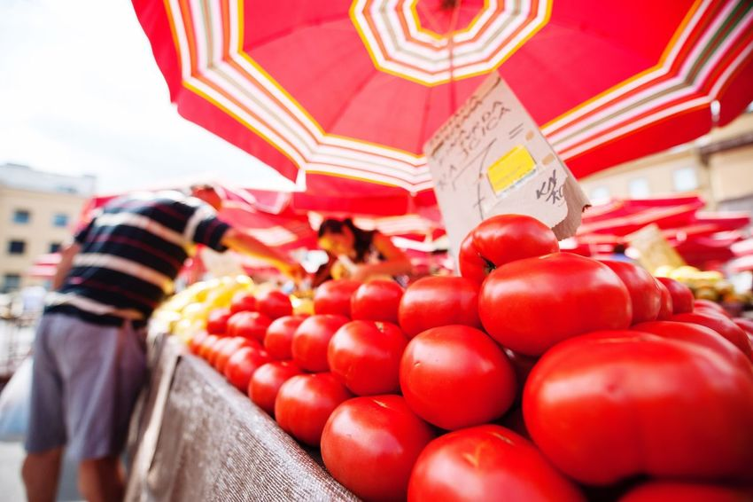 Beautifully Organized at the vegetable market in Zagreb, Croatia Tomatoes Umbrella Red Colors Bright Sunny Taking Photos Travel Photography Market Vegetables City Life Travel OpenEdit Streetphotography Nikon Eye4photography  EyeEm Gallery People Watching Showcase: August Urbanphotography Color Palette Zagreb, Croatia City Miles Away