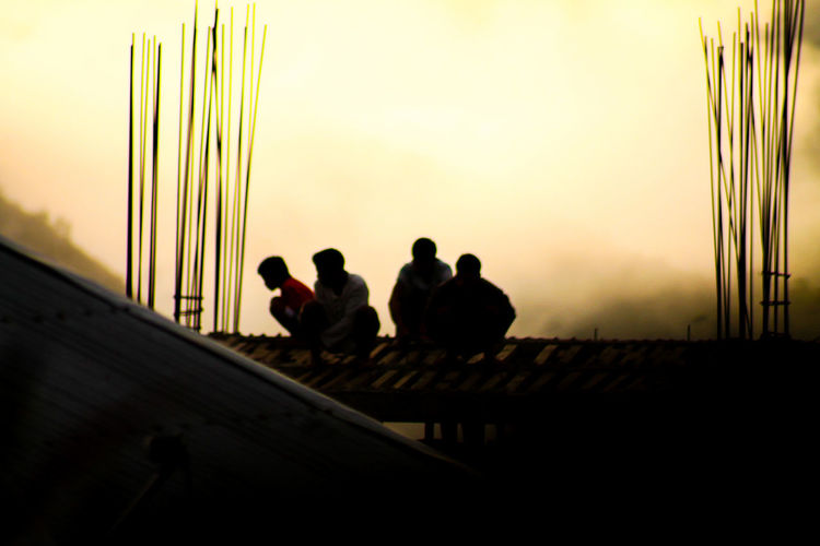 Construction Worker On Break Men Men On The Roof Silhouette Group Of People Business Teamwork People Togetherness Friendship Working Only Men Early Morning Foggy Morning Foggy Dawn Pattern, Texture, Shape And Form Cold Temperature Copy Space People Photography Welcome To Black