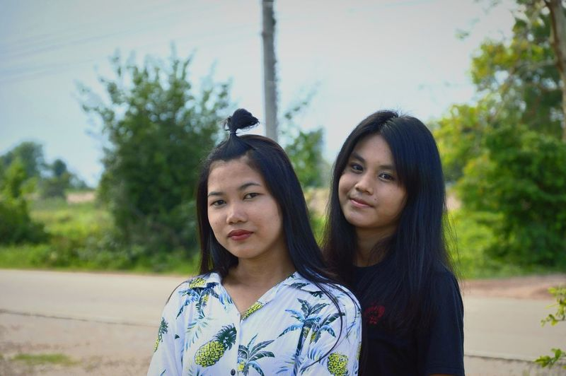Friendship Young Women Women Togetherness Portrait Tree Black Hair Headshot Sky Arm In Arm Campus High School Building Female High School Student Single Parent