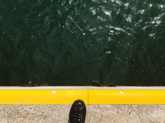 A New Perspective On Life Harbor Sea EyeEm Selects Yellow Water Day Human Leg Shoe High Angle View Transportation