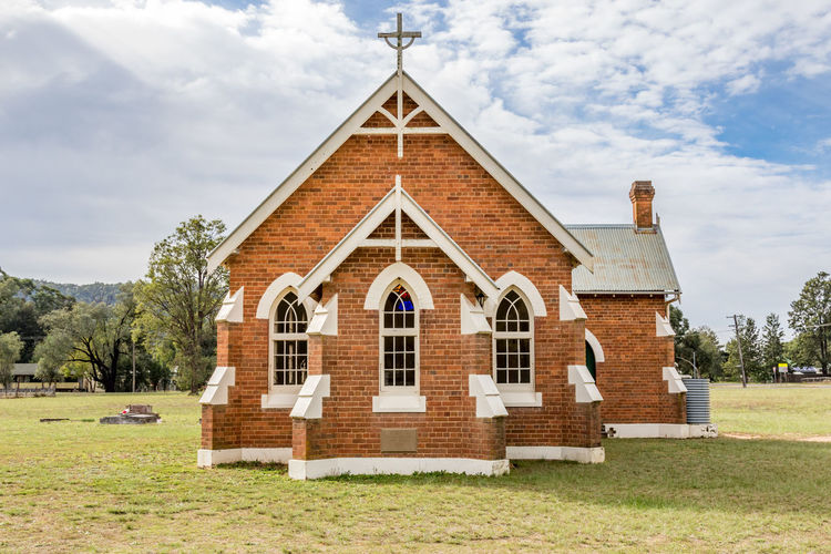 Country church in rural setting Australia Australian Chapel Church Cloudy Country Cross Growth Nature Rural Trees Worship Architecture Brick Building Exterior Built Structure Clouds Day Landscape No People Outdoors Religion Sky Sunshine Window