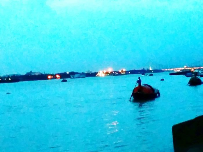 River . Boatmen. Sunset. My city