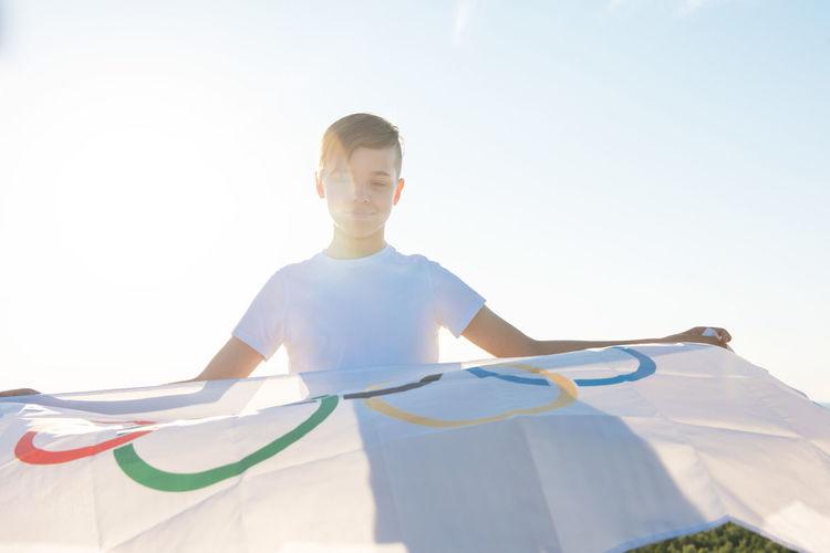 Full length of boy standing against sky