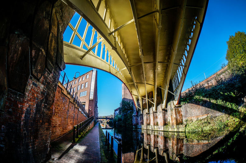 Low Angle View Of Bridge Over Canal Against Sky