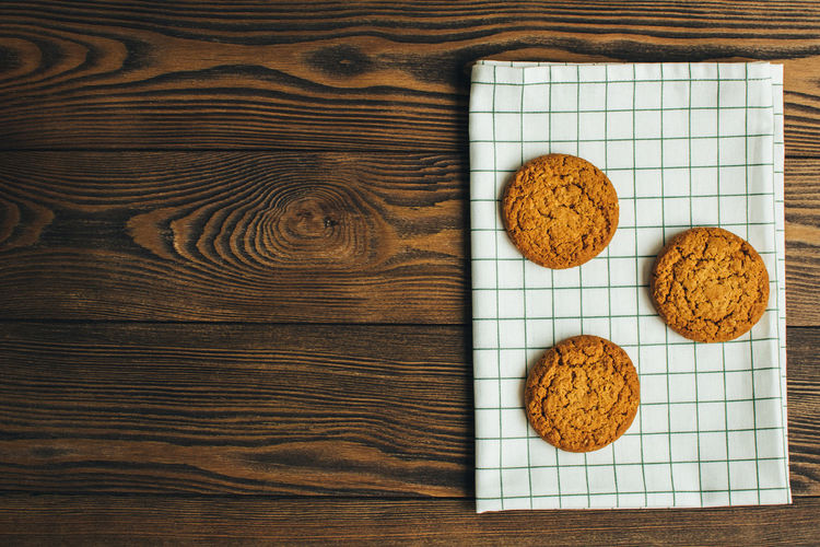 Directly above shot of cookies on wooden table