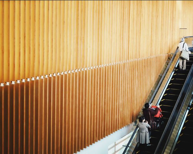 High angle view of people on escalator in shopping mall