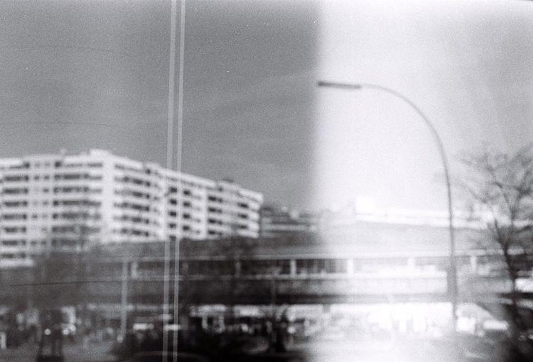 Tilt image of city against sky