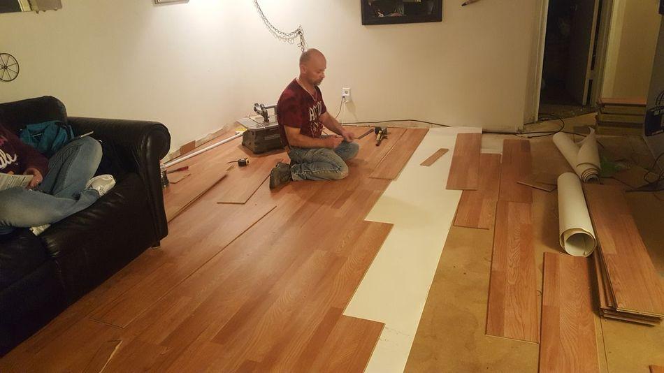 Brother, brett installing hardwood flooring Real People Hardwood Floor Home Interior EyeEmNewHere