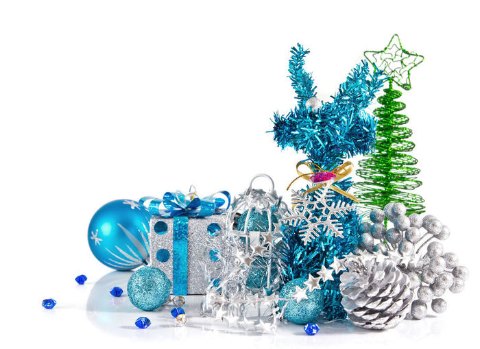 Close-up of christmas decoration against white background