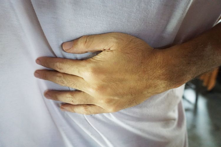 Midsection of man with stomachache