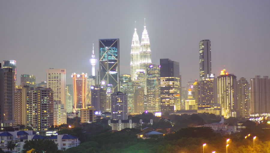 Malaysia city skyline illuminated at night. Architecture Building Building Exterior Built Structure City Cityscape Financial District  Illuminated Landscape Modern Nature Night No People Office Office Building Exterior Outdoors Residential District Sky Skyscraper Spire  Tall - High Tower Urban Skyline