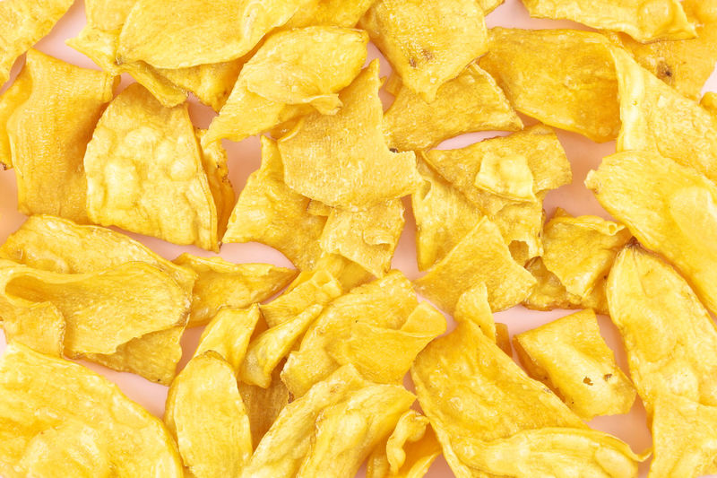 Sliced yellow cassava fried and coating sugar paste as background. Cuisine Pink Tray Background Cassava Chip Close-up Crisp Crunchy Food Fried Healthy Potato Snack Studio Shot Sweet Texture Yellow Yummy