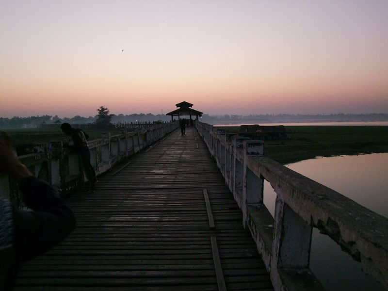 Sunrise over Old U Bein Teak Bridge (built 1782 & 0.7 miles long) over Taungthaman Lake Amarapura Beauty In Nature Blue And Orange Sky Bridge Bridge - Man Made Structure Clear Sky Composition Full Frame Landscape Myanmar No People Orange Sunrise Outdoor Photography Scenics Sunrise Sunrise Photography Taungthaman Lake Teak Bridge Teak Wood Bridge The Way Forward Tourism Tourist Attraction  Tourist Destination Travel Destination U Bein Bridge