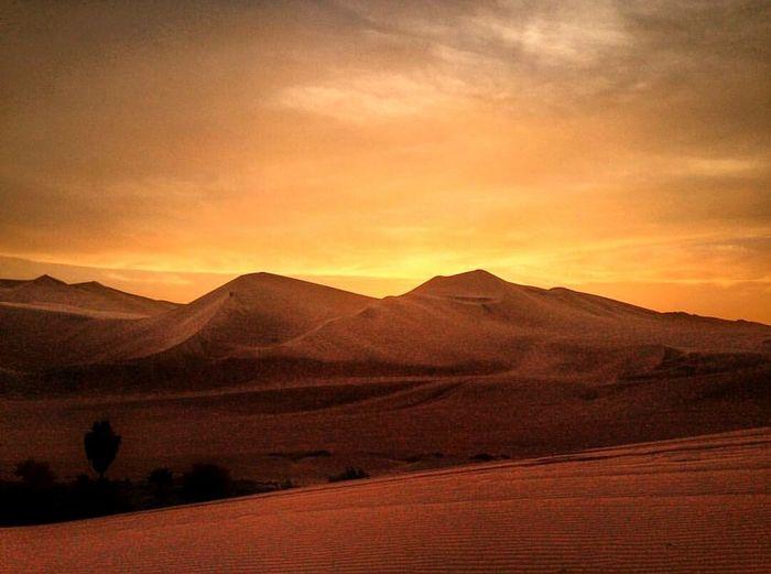 Desert Sunset Mountain Landscape Dusk Orange Color Scenics Outdoors Sand Dune Dramatic Sky Nature No People Sky Beauty In Nature Wonderful_places Peru Perutravel Naturelovers Travel Travel Destinations