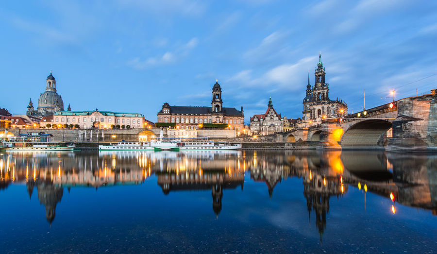 Dresden at night, Germany during twilight blue hour. Ancient Architecture Building Exterior Built Structure Church City City Life Cloud - Sky Famous Place History Illuminated International Landmark Place Of Worship Reflection Religion River Sky Spirituality Tourism Travel Travel Destinations UNESCO World Heritage Site Water Waterfront