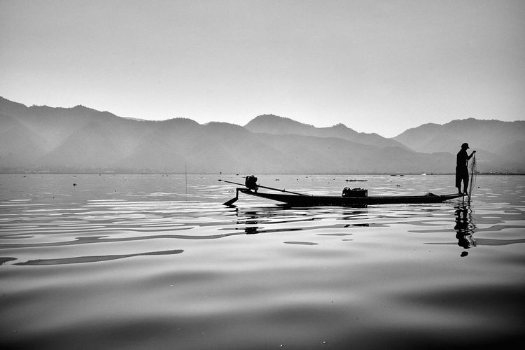 Water Mountain Real People Mode Of Transport Nature Transportation Outdoors Men Nautical Vessel Scenics Mountain Range Oar Day Beauty In Nature Rowing Sky Two People Wooden Raft Outrigger People Inle Lake Myanmar An Eye For Travel The Traveler - 2018 EyeEm Awards