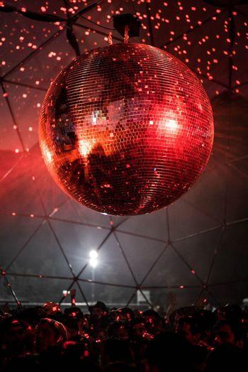 Crowd in illuminated nightclub at night