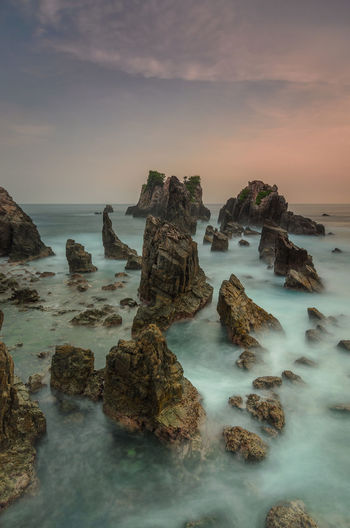 Strong Rock. long exposure makes the photo more dramatic Sea Cloud Wallpaper Gold Cloude Rock Long Exposere Nature Long Exposure Golden Hour Nikon Landascape Lampung Gigi Hiu Water UnderSea Sea Beach Sunset Rock - Object Sky Horizon Over Water Landscape