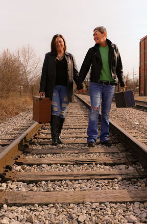 Full Length Front View Togetherness Two People Adult Mature Adult Casual Clothing Adults Only People Mature Women Outdoors Sky Women Day Standing Vacations Portrait Lgbtqi Tracks Train Tracks Friendship.  Travel Love Photography Rural Landscape Couple - Relationship Young Women