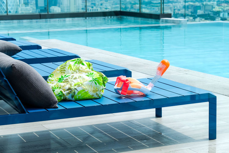 High angle view of food on table at swimming pool