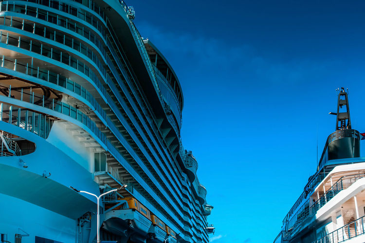 Close view of the cruise ship Sky City Low Angle View Blue Modern Day No People Glass - Material Travel Destinations Sunlight Outdoors Tourism Travel Skyscraper Cruise Boat Ship Cruise Exterior Exterior Structure Balcony Safety Safety Boat