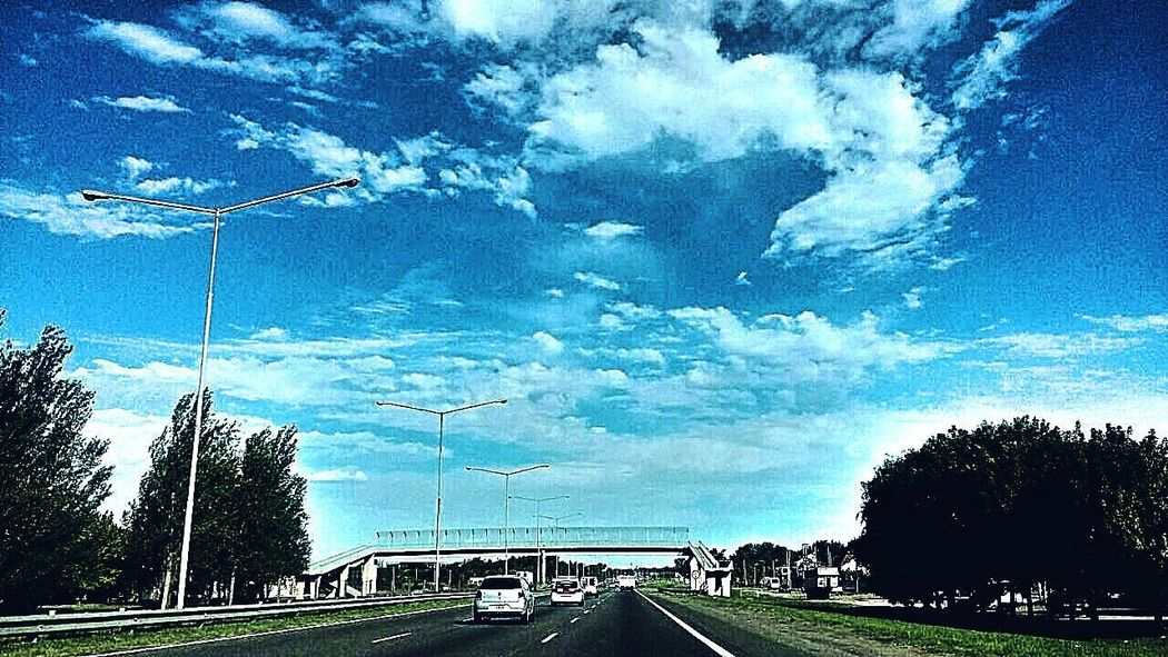 Sky Sky Collection Sky Blue Cielo Y Nubes  Cielo Azul Cielos Y Mares Sky Blue Sky  Tree Transportation Car Mode Of Transport Land Vehicle No People Road Cloud - Sky The Way Forward Nature Growth Day Car Interior Outdoors Beauty In Nature
