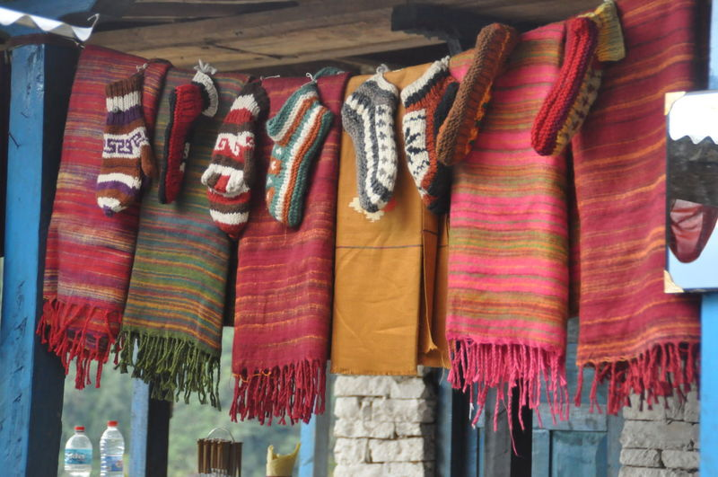 Multi colored blankets hanging for sale